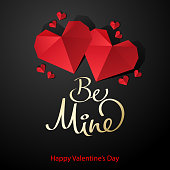 Celebrate the Valentine's Day with heart shape paperart on the black background