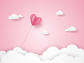 Valentines day , Illustration of love , pink heart balloon flying in the pink sky , paper art style
