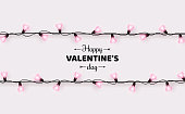 Happy Saint Valentine's day card with pink heart shaped light bulbs on white background. Holiday illuminated border made of garland wire