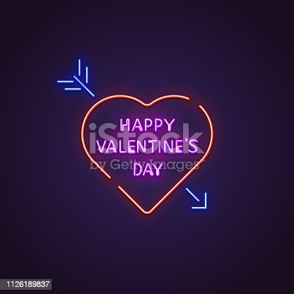 Valentines day neon sign. Glowing neon sign of text Happy Valentine`s Day. Letters glowing in retro colors. February 14 holiday.