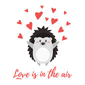 Vector cartoon style illustration of Valentine's day romantic gift card with cute hedgehog and red hearts around it. Love is in the air text.