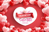 Valentine's Day Sale 50% off Poster or banner with many sweet hearts on red background.Promotion and shopping template or background for Love and Valentine's day concept