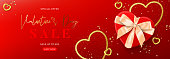 Valentine's Day sale horizontal banner. Vector illustration with realistic gift box, candles, gold hearts and confetti on red background. Promo discount banner.