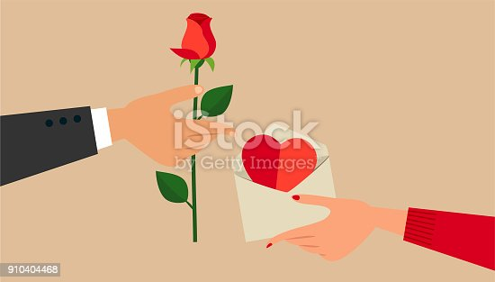 Man's and woman's hands, exchanging Valentine's Day gifts.
