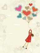 Little girl flying by heart-shaped helium balloons. Copy space at the left side.