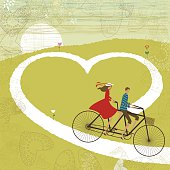 Valentine's card with couple cycling through a heart shaped road.