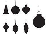 Various different styles of Christmas bauble ornaments in silhouette.