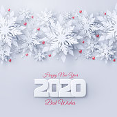 Vector 2020 Happy New Year and Merry Christmas background with realistic looking paper cut 3d snowflakes. Seasonal holidays white paper style greeting card
