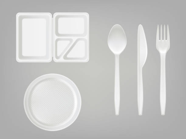 Vector 3d realistic disposable plastic lunch box, plate, spoon, fork, knife. Picnic tableware set on gray background. Vector 3d realistic disposable plastic lunch box with partition, plate, cutlery - spoon, fork, knife. Picnic party tableware isolated icons set on gray background. Template, mockup of eco kitchenware polystyrene stock illustrations