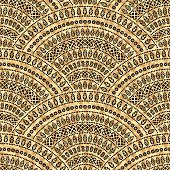 Vector abstract seamless geometrical background from black fan shaped ornate elements with ethnic patterns. Golden wavy metallic background. Folklore, tribal. Art deco wallpaper, wrapping paper, batik paint, textile print, covering