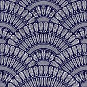 Vector abstract seamless geometrical background from  fan shaped ornate elements with ethnic patterns. Silver wavy metallic feathers on a dark indigo blue background. Folklore, tribal. Art deco wallpaper, wrapping paper, batik paint, textile print, coveri