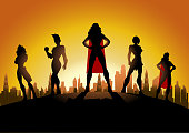 A silhouette style illustration of a team of female superheroes with city skyline in the background