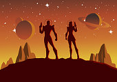 A silhouette style vector illustration of a couple of astronauts with outer space in the background. Wide space available for your copy.