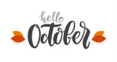 Vector Autumn handwritten type lettering of Hello October with fall leaves.