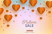 Autumn sale background template with papercut orange air balloons. Modern origami paper flying objects and space for advertising text. Vector backdrop, wallpaper illustration