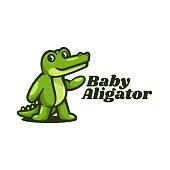 istock Vector Baby Alligator Simple Mascot Style 1256624975