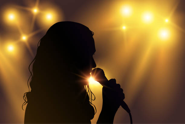 Vector black silhouette of female singer with yellow spotlights in the background Vector black silhouette of female singer with yellow spotlights in the background singer stock illustrations