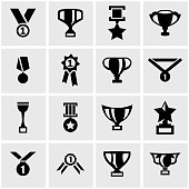 Vector black trophy and awards icon set on grey background
