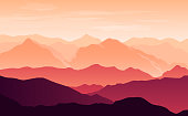 Vector bright silhouettes of orange and purple mountains in the evening with clouds in the sky