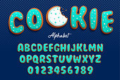 Vector cartoon font and alphabet in the form of cookies in royal icing with decorative tiny balls made with sugar for decoration. Isolated on darck transparent background