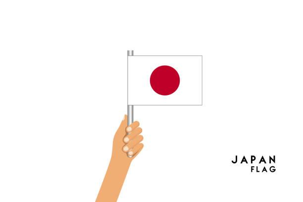 ilustraciones, imágenes clip art, dibujos animados e iconos de stock de ilustración de dibujos animados de vectores de manos humanas sostienen la bandera de japón. objeto aislado sobre fondo blanco. - bandera japonesa