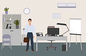 Vector cartoon illustration of the first working day at office. Confident happy man standing near his new workplace with a desk, a printer, a computer.