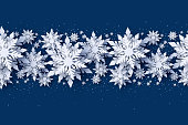 Merry Christmas and Happy New Year seamless pattern design with 3d white realistic layered paper cut snowflakes on blue background. Vector seasonal new year Christmas seamless decoration