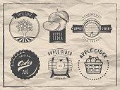 Vector cider logos and badges. Set of retro labes for apple cider drink. Vintage paper background.