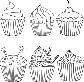 Vector cupcake illustration. Set of hand drawn cupcakes. Doodle cakes with cream and berries.
