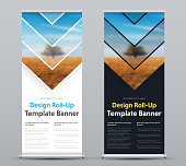 Vector design of roll-up banner with arrows and place for photo. Templates of black and white for business, advertising and printing. Set