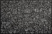 Chalkboard vector hand drawn doodle cartoon set of School objects and symbols