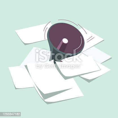 istock Vector drawn megaphone and scattered paper. 1253347182