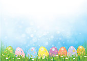 Vector Easter eggs in green  grass,   Easter background.