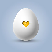 istock Vector egg with a yellow heart 1211414615