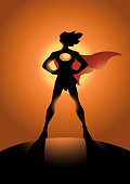 A vector silhouette illustration of a female superhero with sun sets behind.