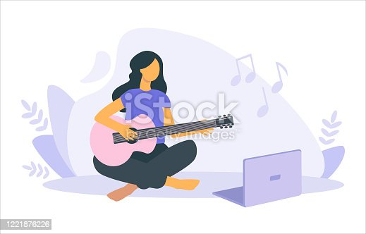 istock Vector flat illustration of girl e-learning to play the guitar with a laptop at home. 1221876226