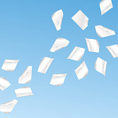 Vector flying shaded white papers on blue background.