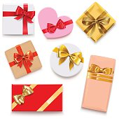 Vector cardboard gift boxes with red and golden bow, isolated on white background