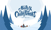 Vector greeting card. Snowy landscape background with hand lettering of Merry Christmas and cartoon houses.