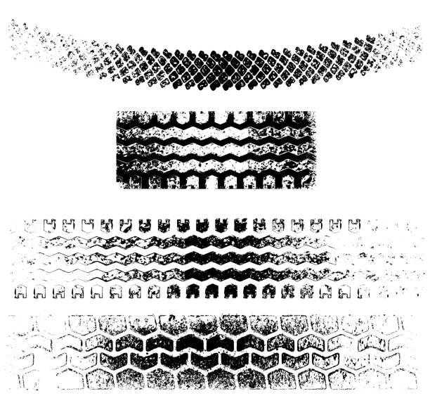 Vector grunge tire tracks vector art illustration