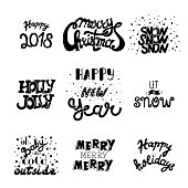 Vector hand drawn ChristmaVector hand drawn Christmas and New Year quotes and wishes. Hand draw lettering set. Happy 2018, Merry Christmas, Holly Jolly, Let it's snow, Happy New Years and New Year quotes and wishes. Hand draw lettering set.