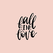 Vector hand lettering phrase Fall In Love. February 14 calligraphy on pink background. Valentines day typography