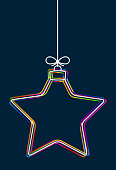 Vector hanging abstract colorful Christmas ball on a string with a bow consisting of multicolored outlines on dark blue background. Vector EPS10