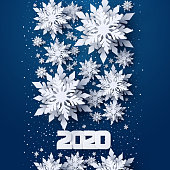 Vector Happy New Year 2020 holidays banner with realistic looking paper cut snowflakes on dark blue background. Seasonal wishes Merry Christmas and Happy New Year greeting card