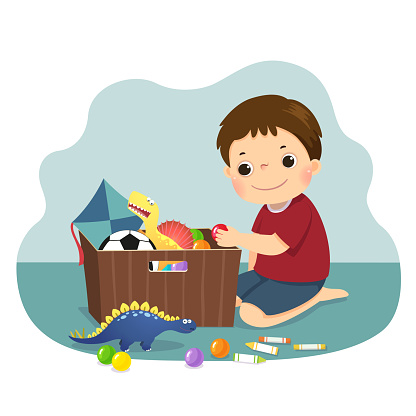 Vector illustration cartoon of a little boy putting his toys into the box. Kids doing housework chores at home concept.