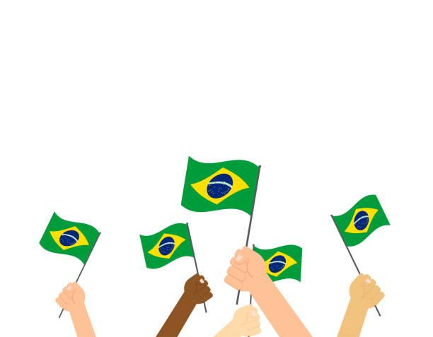 bildbanksillustrationer, clip art samt tecknat material och ikoner med vektor illustration händer som håller brasilien flaggor på vit bakgrund - brasilien flagga