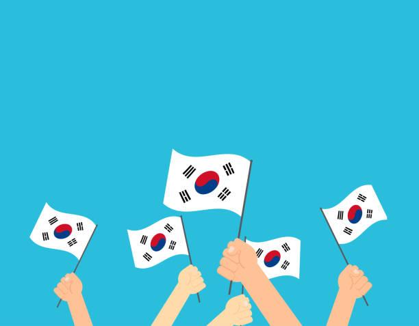 ilustrações, clipart, desenhos animados e ícones de mãos de ilustração vetorial segurando bandeiras da coreia do sul - cartão do dia da independência de coreia do sul - bandeira da coreia
