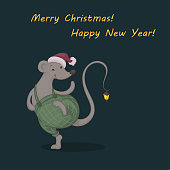 Vector illustration of a cartoon cute dancing mouse in a green checkered trousers and Santa cap with a glowing lantern on its tail on the dark background. Yellow greeting Merry Christmas and Happy New Year