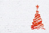 Red and white color brick pattern wall texture grunge background vector illustration. A scribbling of a hand drawn Christmas tree with one star at the top is  towards the right in the frame. Horizontal frame. Brick wall with rectangular blocks, textured grungy backgrounds. No text. No people, copy space, copyspace. The masonry joints joint are white in color.  Xmas, Christmas theme background, backgrounds, wallpaper, greeting card, gift wrapping paper.