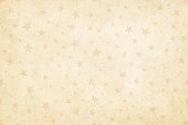 Vector Illustration of a semi seamless background (design only, not grunge) in Vintage light brown color, pale dull party and celebration elements like swirls, stars, confetti on a grunge beige starry background. Only the pattern of objects on the background is seamless, while the grunge is not., No text, no people, light and faint watermark christmas objects. Objects scattered randomly over the background. Can be used as a wallpaper, Xmas background, gift wrapping sheet or Birthday party or  New Year celebration background.